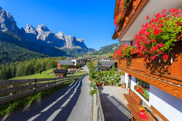 Street in Colfosco alpine village in Dolomites Mountains, Italy