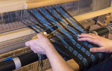 Woman Weaving Using a Boat Shuttle