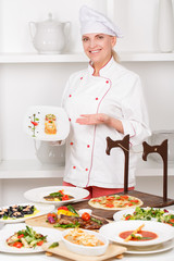 Cook stands before the table with meals