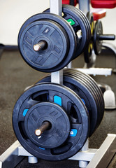 Barbell plates holder in gym