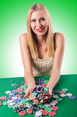 Woman in casino playing cards