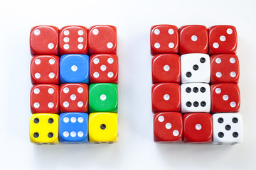 Coloured playing dice on white background