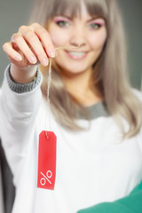 Woman holding discount label. Sale and retail.