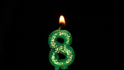 Candle in the form of eight