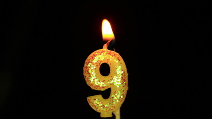 Candle in the form of nine