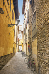Street with bicycles in Florence in Italy in summer