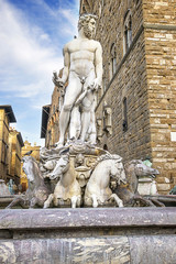 Neptune statue near the Old Palace (Palazzo Vecchio) on Square o