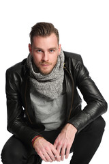 Man sitting down in a leather jacket