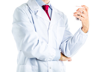 Doctor in white coat holding a glass of steel screws