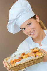 Woman holding a basket of choux pastry