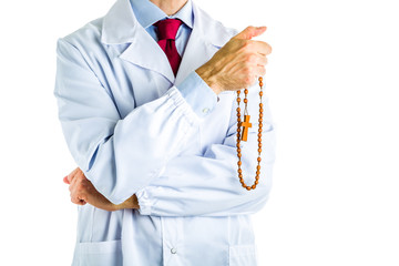Doctor in white coat holding wooden Rosary beads