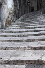 Stone stairway in old Taranto, Italy.
