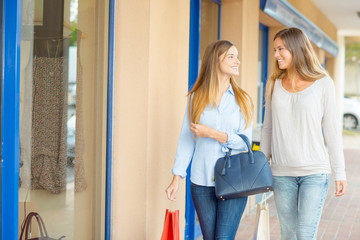 Two female friends shopping together
