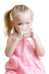child drinking milk from glass