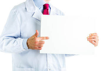 Doctor in white coat showing a white blank signboard