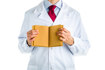 Doctor in white coat showing a blank book