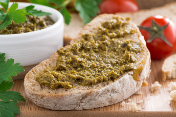 Italian appetizer - ciabatta with pesto, selective focus