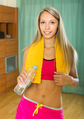 Girl with towel and bottle of water
