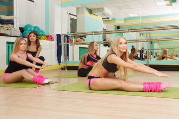 Group of pretty girls doing workout in gym