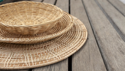 Rattan set selective focus on wood background