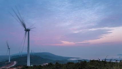 wind farm in sunrise by jiangxi poyang lakeside , time lapse