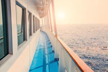Cruise ship in sea at sunset