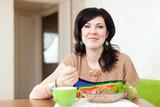 woman eats buckwheat