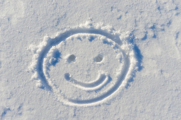 cheerful smiley face drawn on snow