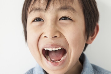 Boy laughing and wide open mouth