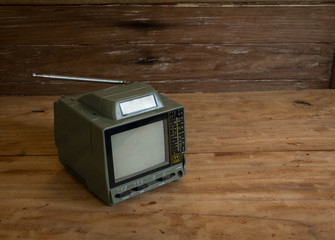 Old TV on the old wooden floor.still life