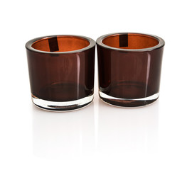 Two stylish ceramic candlesticks with reflection