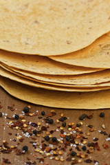 stack of tortillas and spices