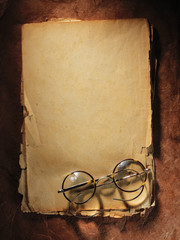 Vintage glasses on old paper