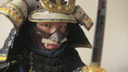 ancient Japanese samurai with katana menacingly posing, close up