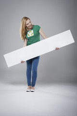 Activist for recycling holding empty whiteboard