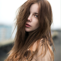 portrait of a beautiful young woman in a windy weather