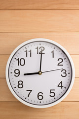 wall clock on wood