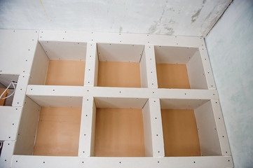 design of the drywall in the room apartment