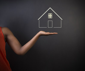 African American woman teacher with home house or real estate