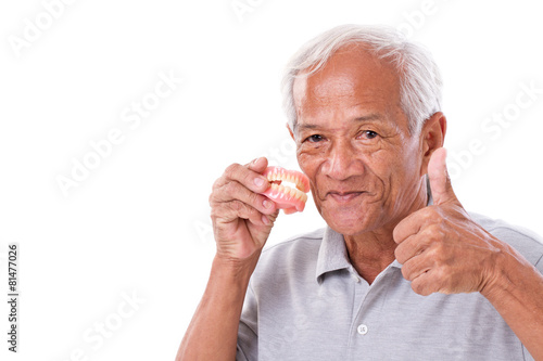 Poster senior man with denture, giving thumb up
