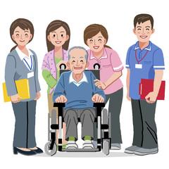 車椅子 シニア Smiling Senior man in wheelchair and nursing carers