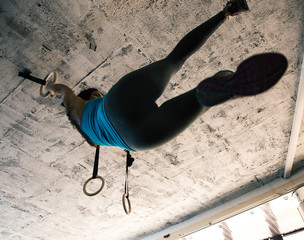 Woman doing exercise with gimnastic rings
