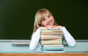 cheerful girl with textbooks