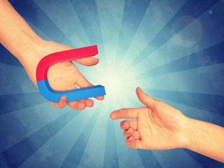 Right hand taking blue and red magnet