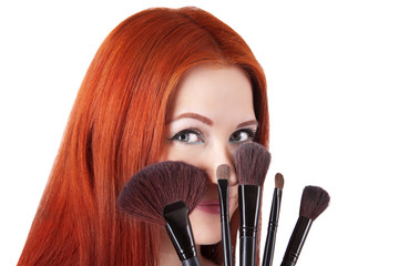 Girl makeup artist with brushes closeup