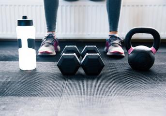 Closeup image of a woman sitting at gym