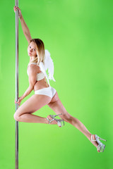blond in angelic wings makes element at pole dance