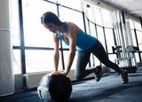 Fototapety Young woman doing exercise with fit ball
