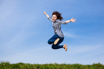 Teenage girl running, jumping outdoor