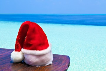 Santa hat is on a beach table